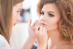 Professional Make-up artist doing glamour model Stock Images