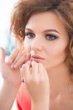 Professional Make-up artist doing glamour model Stock Photo