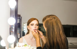 Professional Make-up artist doing glamour model makeup at work Royalty Free Stock Photography