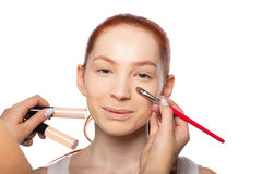 Professional Make-up artist doing glamour with red Stock Image
