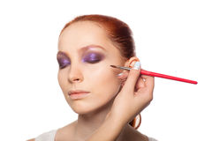 Professional Make-up artist doing glamour with red Stock Photos