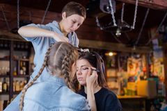 Make-up artist and hairdresser working with woman client Stock Photography