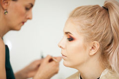Professional Make up artist in working process Royalty Free Stock Photos