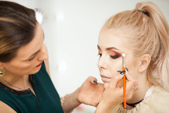 Professional Make up artist in working process Royalty Free Stock Photo