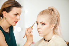 Professional Make up artist in working process Royalty Free Stock Image