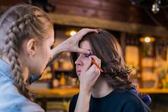Make-up artist working with woman client royalty free stock photo