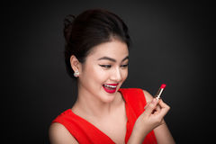 Free Professional Make-up. Attractive Asian Model Applying Red Lipstick. Stock Photos - 94168043