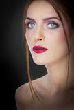 Professional make up - beautiful female art portrait with beautiful eyes. Elegance. Genuine natural woman in studio. Portrait. Of a attractive woman with red Royalty Free Stock Image