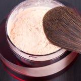 Professional make-up brush on box with powder Royalty Free Stock Photo