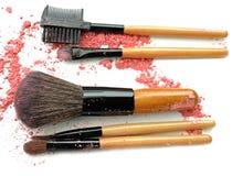 Professional make-up brush on colorful crushed eyeshadow. Royalty Free Stock Photography