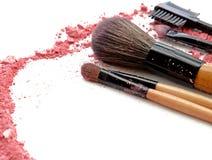 Professional make-up brush on colorful crushed eyeshadow. Royalty Free Stock Photo