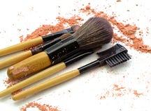 Professional make-up brush on colorful crushed eyeshadow. stock images
