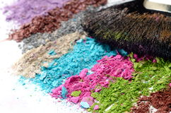 Professional make-up brush on colorful crushed eyeshadow Stock Images