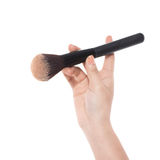 Professional make-up brush cosmetic in female hand isolated on w Royalty Free Stock Image