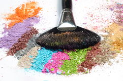 Professional make-up brush on crushed eyeshadow Stock Photos