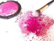 Make-up brush on  magenta make-up powder stock images