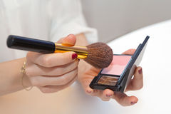 Professional make up brush on pink blush Royalty Free Stock Images