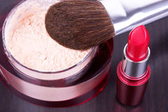 Professional make-up brush on powder and lipstick Royalty Free Stock Photos