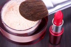 Professional make-up brush on powder and lipstick Royalty Free Stock Photos