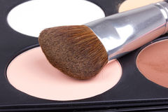 Professional make-up brush on white eyeshadows Stock Photography