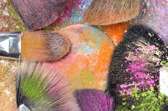 Professional make-up brushes on colorful eyeshadow Stock Photos