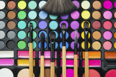 Professional make up brushes on eyeshadow palette Royalty Free Stock Images