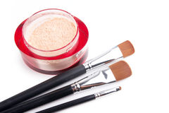 Professional make-up brushes and powder on white Stock Photo