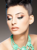 Professional make-up and hairstyle on beautiful woman Stock Photos