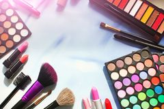 Professional make up set with copyspace: eyeshadow palette, lipstick, make-up brushes. Film and flare effect. Top view, flatlay Stock Image