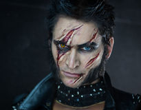 Professional make-up werewolf Wolverine. With scars Royalty Free Stock Image