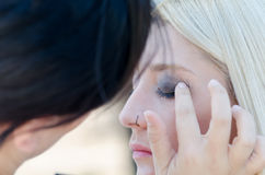 Professional makeup artist applying make up outdoor Royalty Free Stock Photo