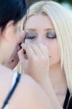 Professional makeup artist applying make up outdoor Royalty Free Stock Photos