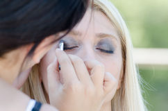 Professional makeup artist applying make up outdoor Stock Images