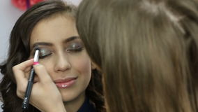 Professional makeup artist finishes stock video footage