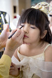 Professional makeup artist working with cute asian child Royalty Free Stock Photography