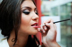 Professional makeup with a beautiful young woman Royalty Free Stock Photography
