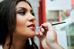 Professional makeup with a beautiful young woman Stock Photos