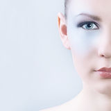 Professional Makeup for Brunette with Blue eyes. Part of face. Stock Photography