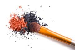 Professional makeup brush and loose powder eyeshadows isolated Stock Image