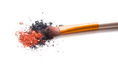 Professional makeup brush and loose powder eyeshadows isolated Stock Photography