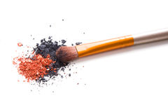 Professional makeup brush and loose powder eyeshadows isolated Stock Photo