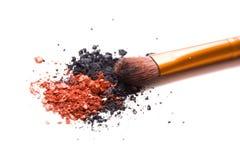 Professional makeup brush and loose powder eyeshadows isolated Stock Photos