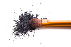 Professional makeup brush and loose powder eyeshadows isolated Royalty Free Stock Photos
