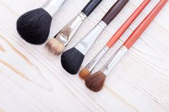Professional makeup brush on white wooden background Stock Photos
