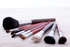 Professional makeup brush on white wooden background Royalty Free Stock Image