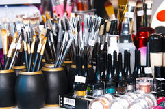 Professional makeup brushes and eye shadows Stock Image