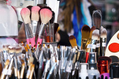 Professional makeup brushes and eye shadows Stock Photos