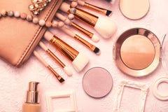 Professional Makeup Brushes, Golden Bronzer And Blush, Foundation And Various Cosmetics Stock Photos