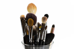 Professional makeup brushes isolated in a glass. Professional makeup brushes  in a glass on a white background Royalty Free Stock Images