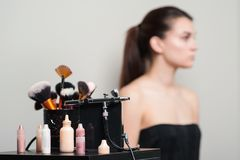 Professional makeup brushes, modern airbrush and tools. Make-up products set. Make up application tools. Cosmetics and brushes on. On artist workplace royalty free stock photos